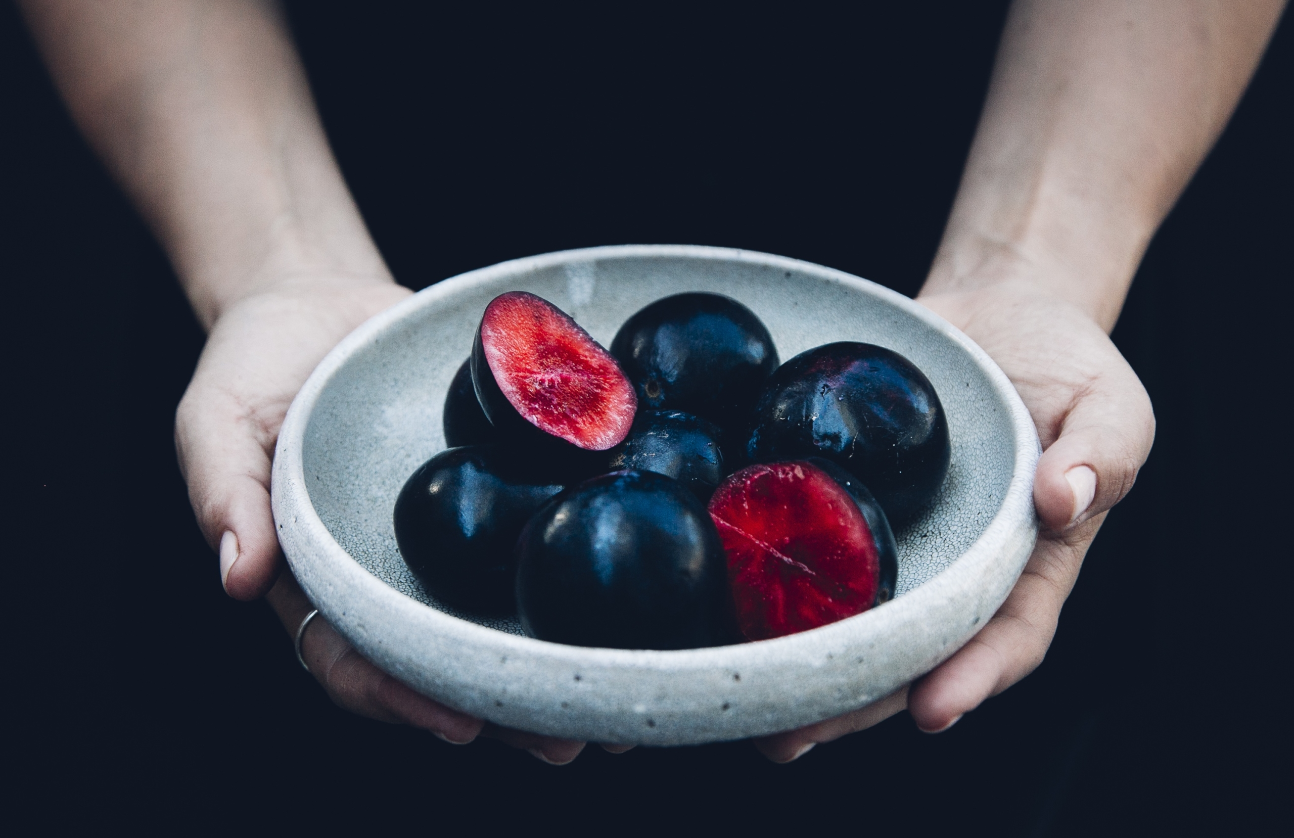 Davidson plum bowl with hands